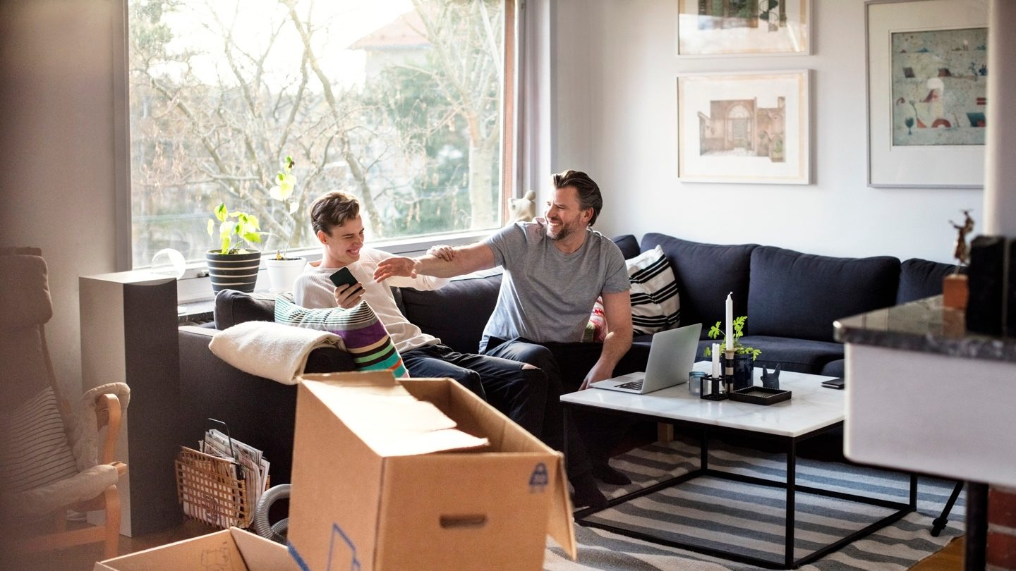 father-and-son-moving-into-home-with-family-guarantee