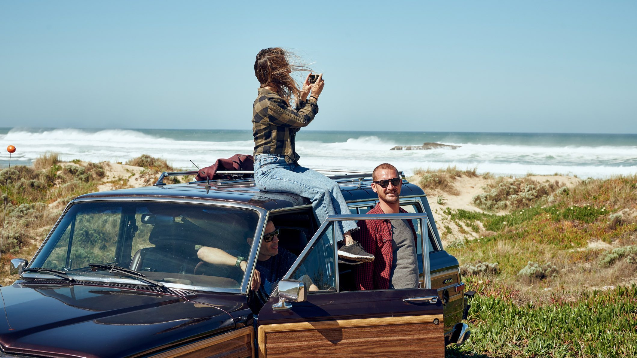 People sitting in rental car on Tasmanian coast after government grants were offered to car owners to rent out their vehicles.