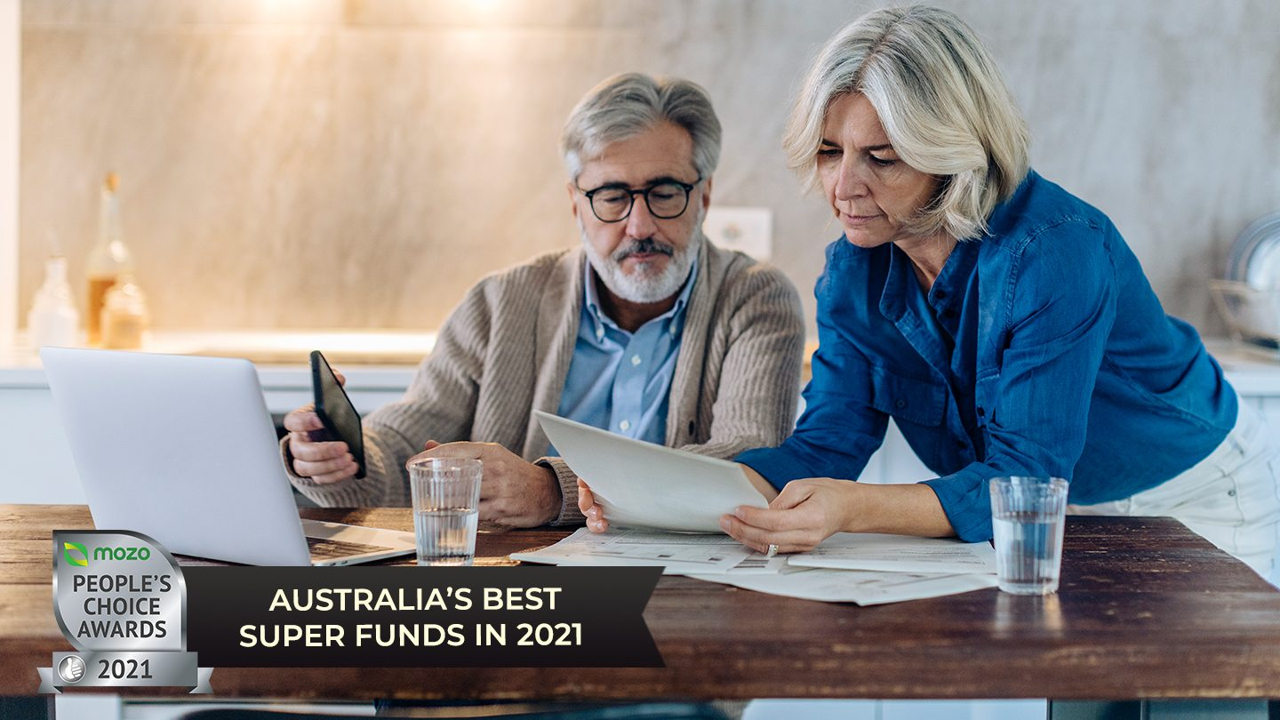 man-and-woman-looking-at-best-superannuation-on-laptop