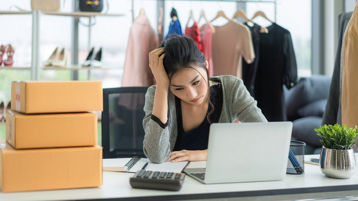 Woman business owner stressed