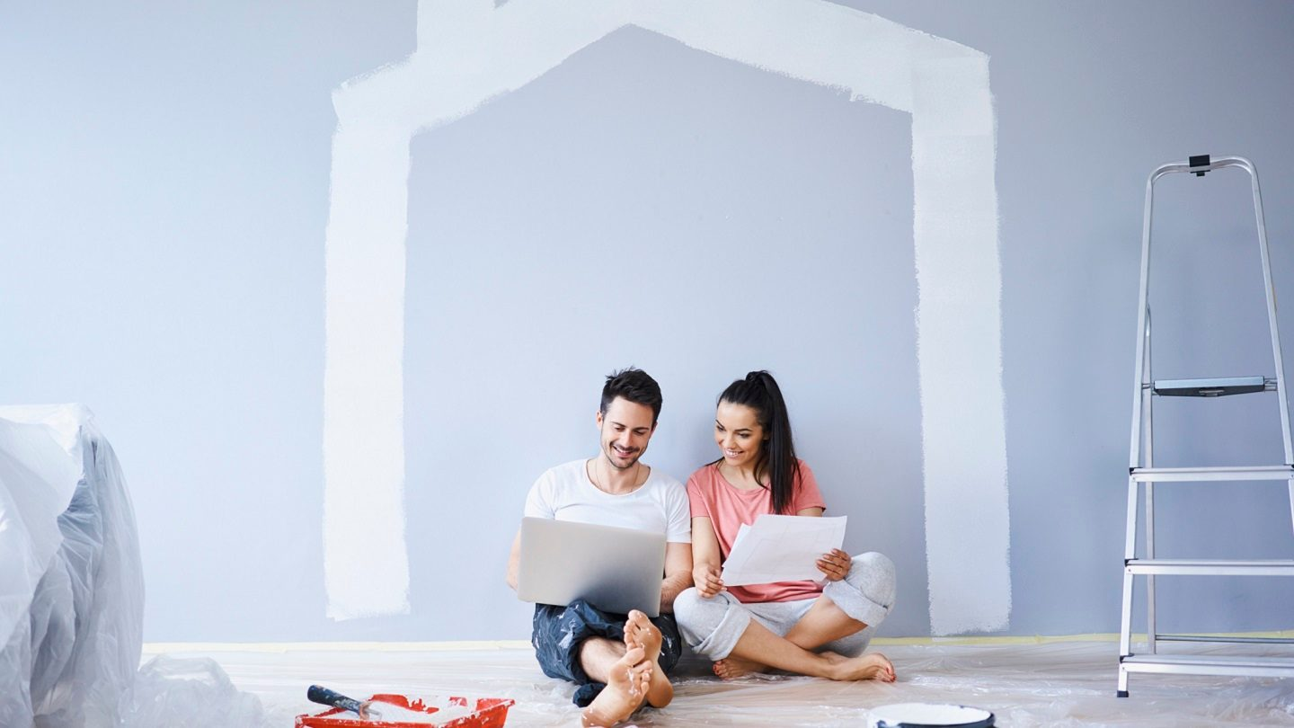 Couple looking at home loan options