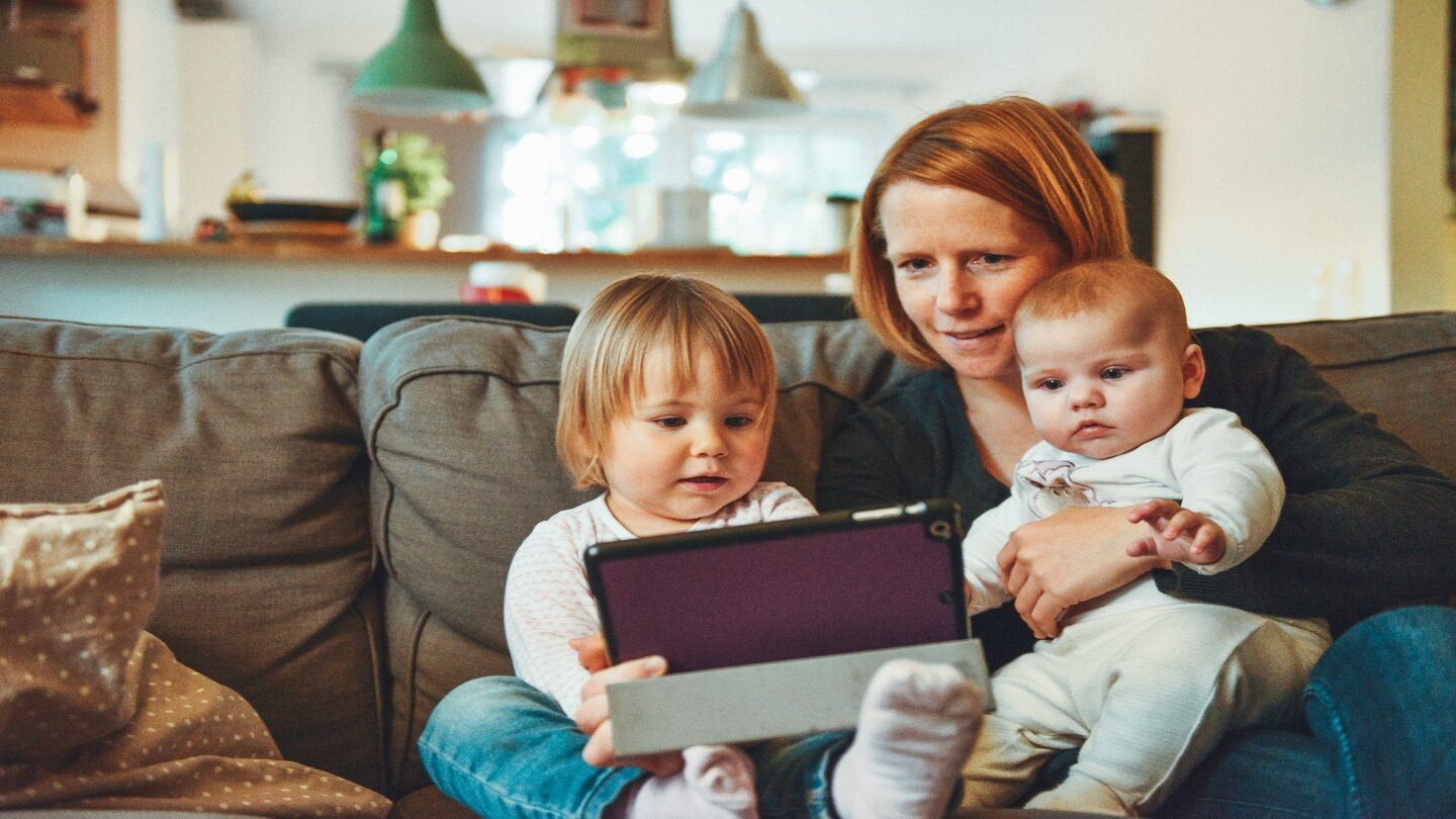 family looking at homes online ipad