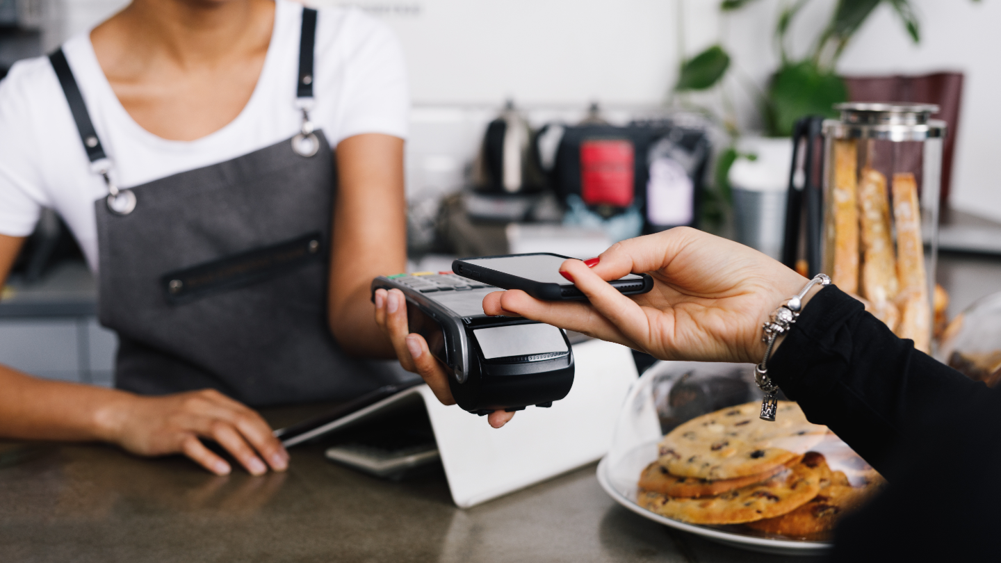 using a digital wallet to pay at a cafe