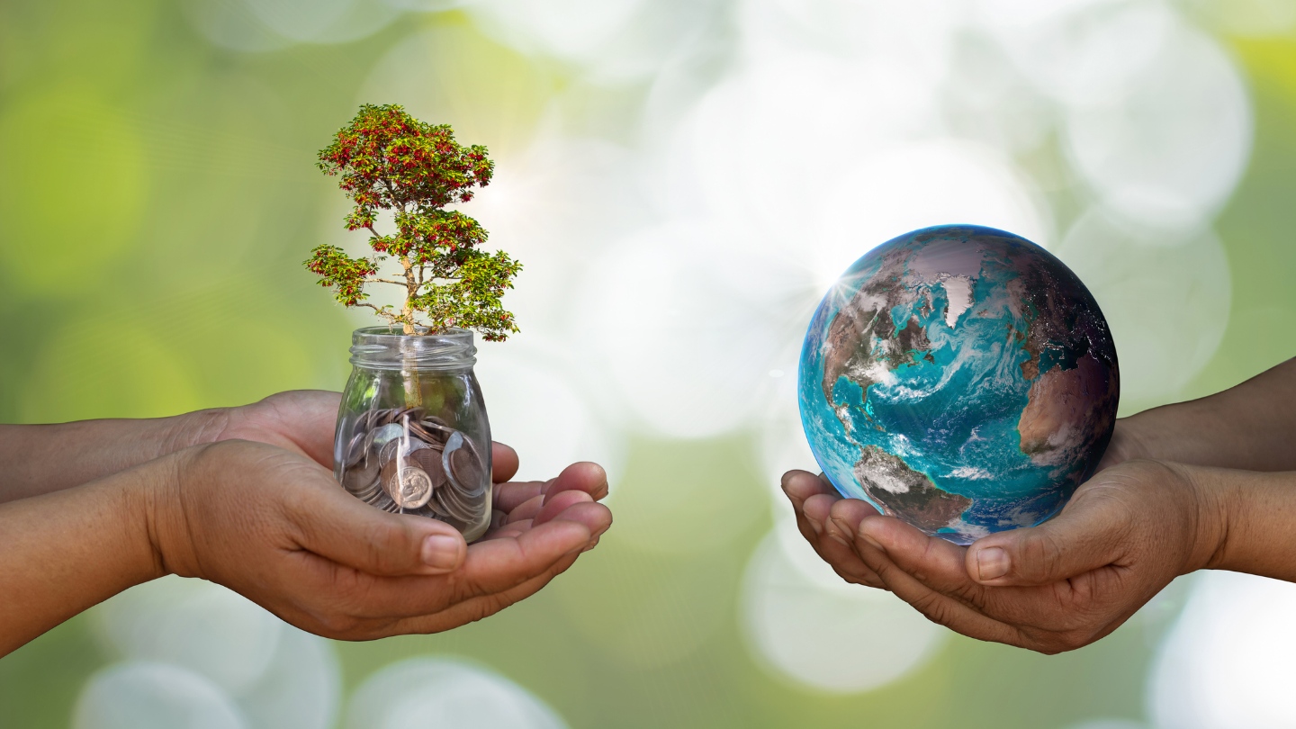 A hand holding a globe and another hand holding a jar with a tree sprouting from coins in a green background promoting green home loans