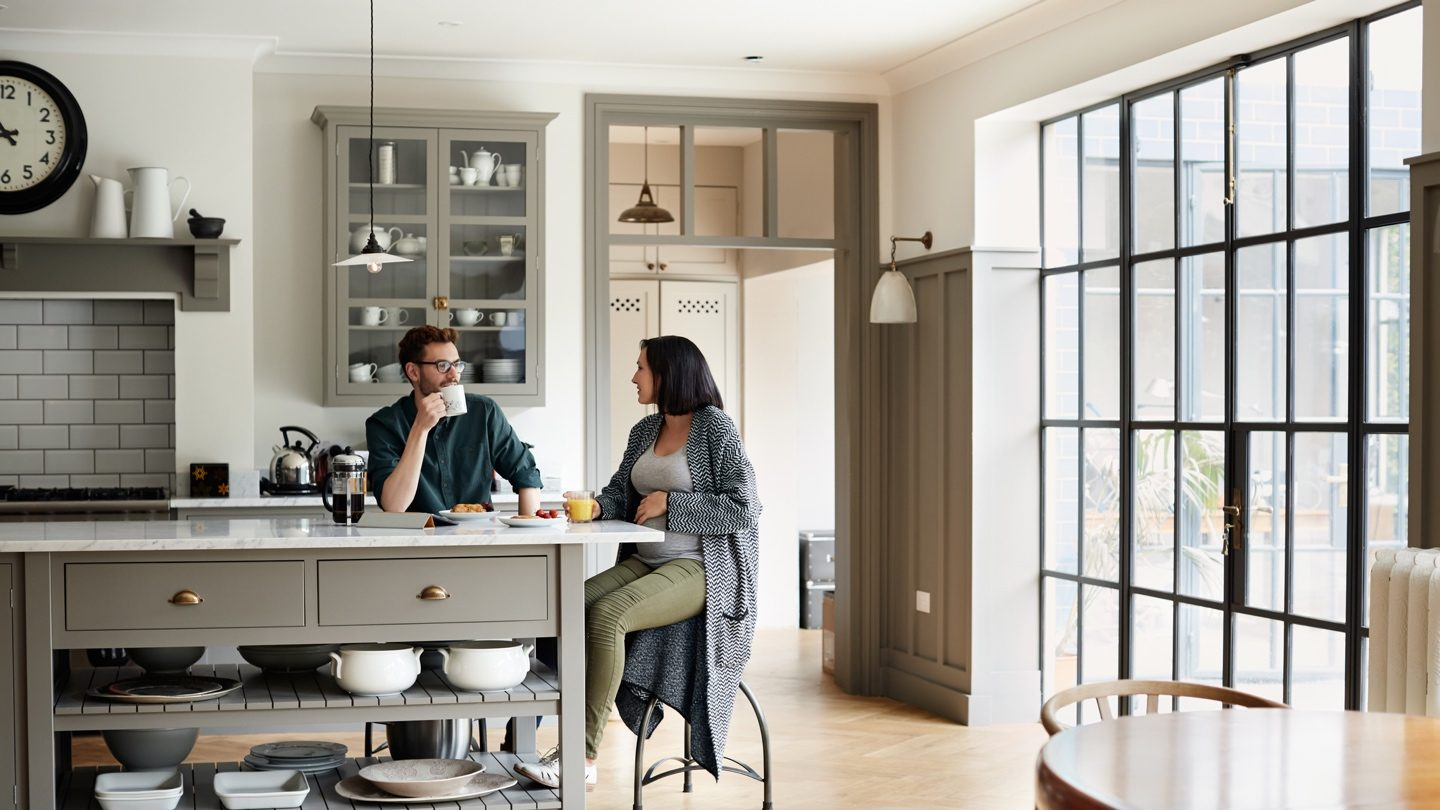 couple-refinancing-home-loan-in-kitchen