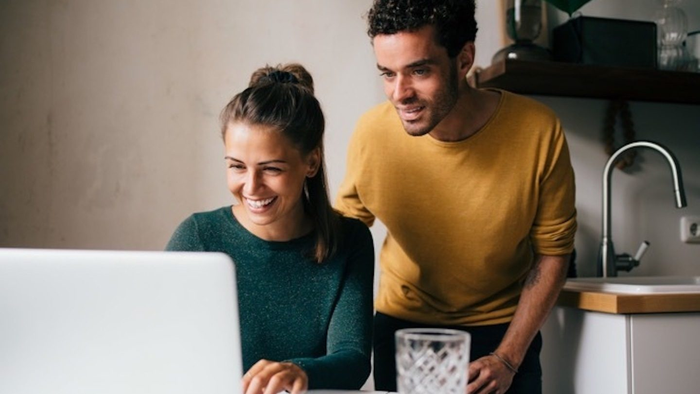 couple applying for personal loan on their laptop
