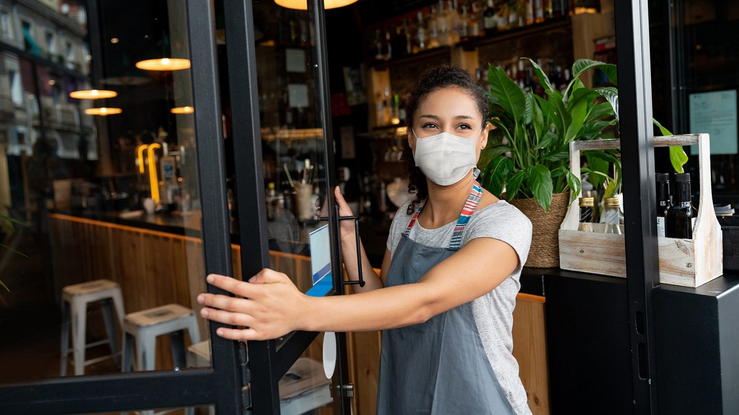 Small business owner wearing mask.