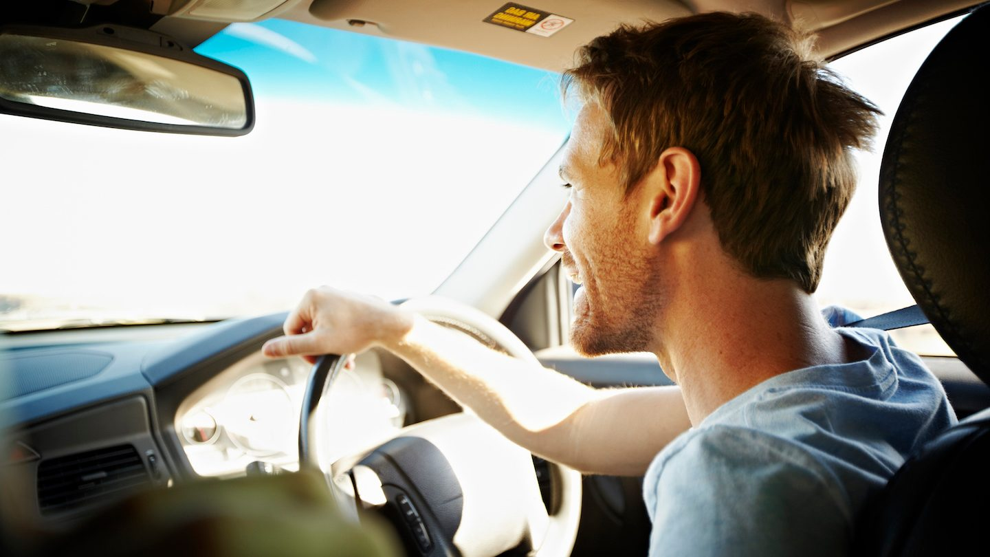 man driving car purchased with car loan
