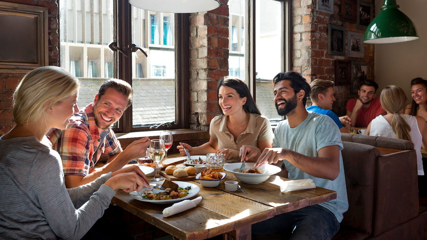 people eating in a restaurant using buy now pay later