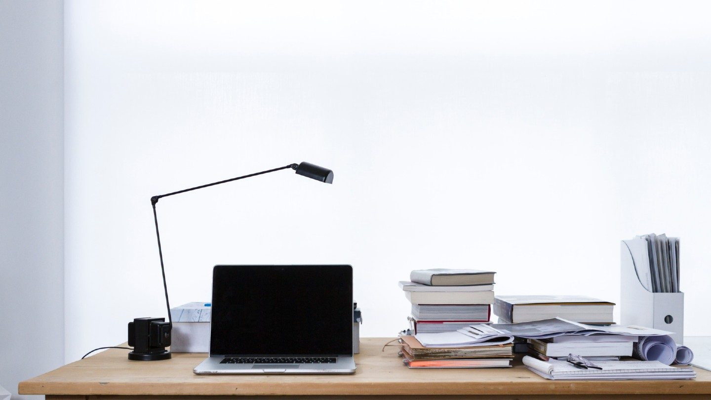 Laptop, books and lamp on a desk