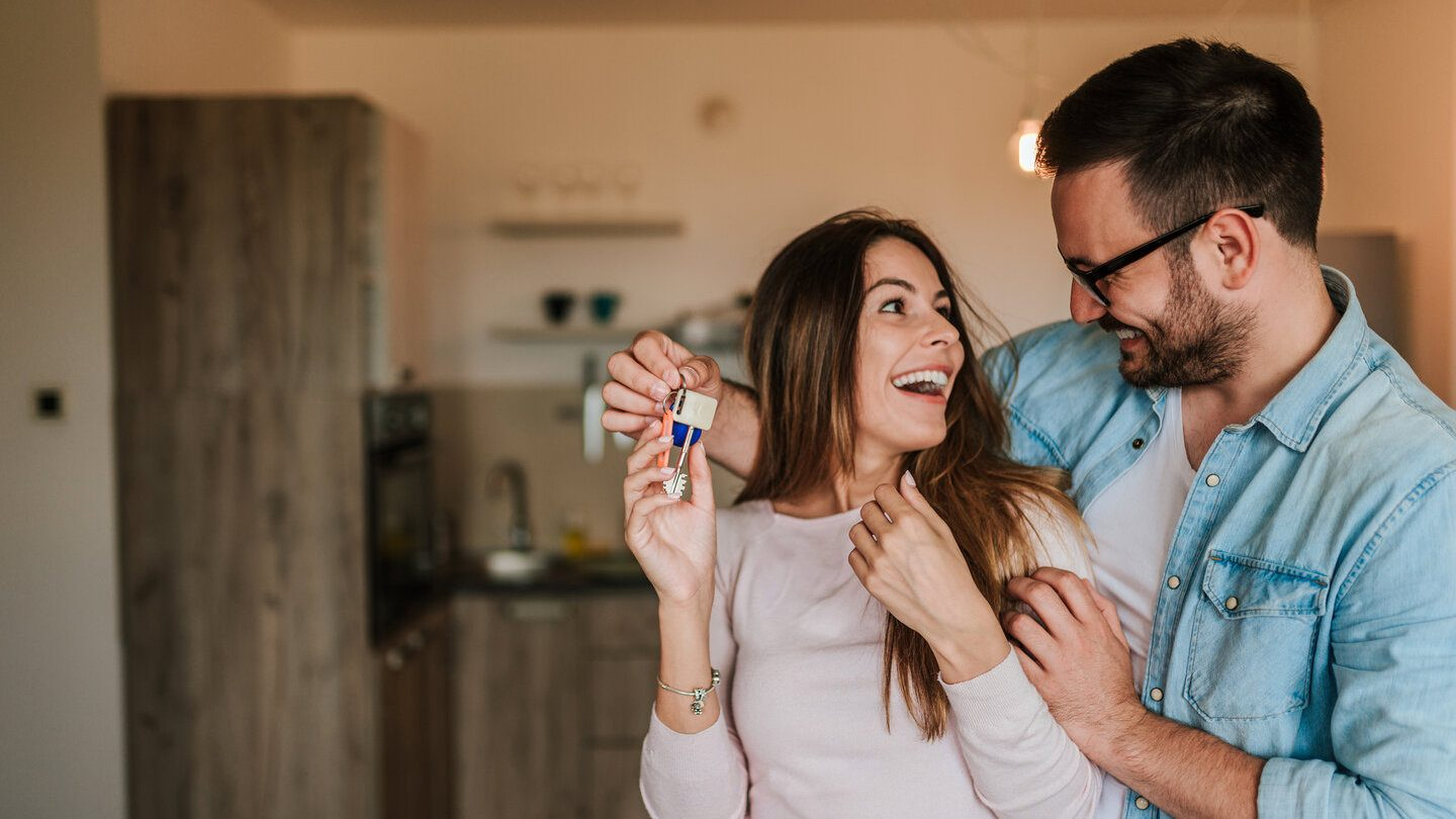 happy couple on a joint home loan happy to get their official house keys