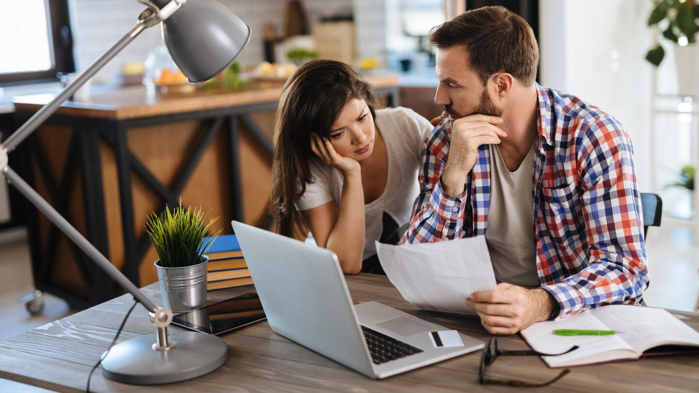 couple anxious about getting a default on their home loan