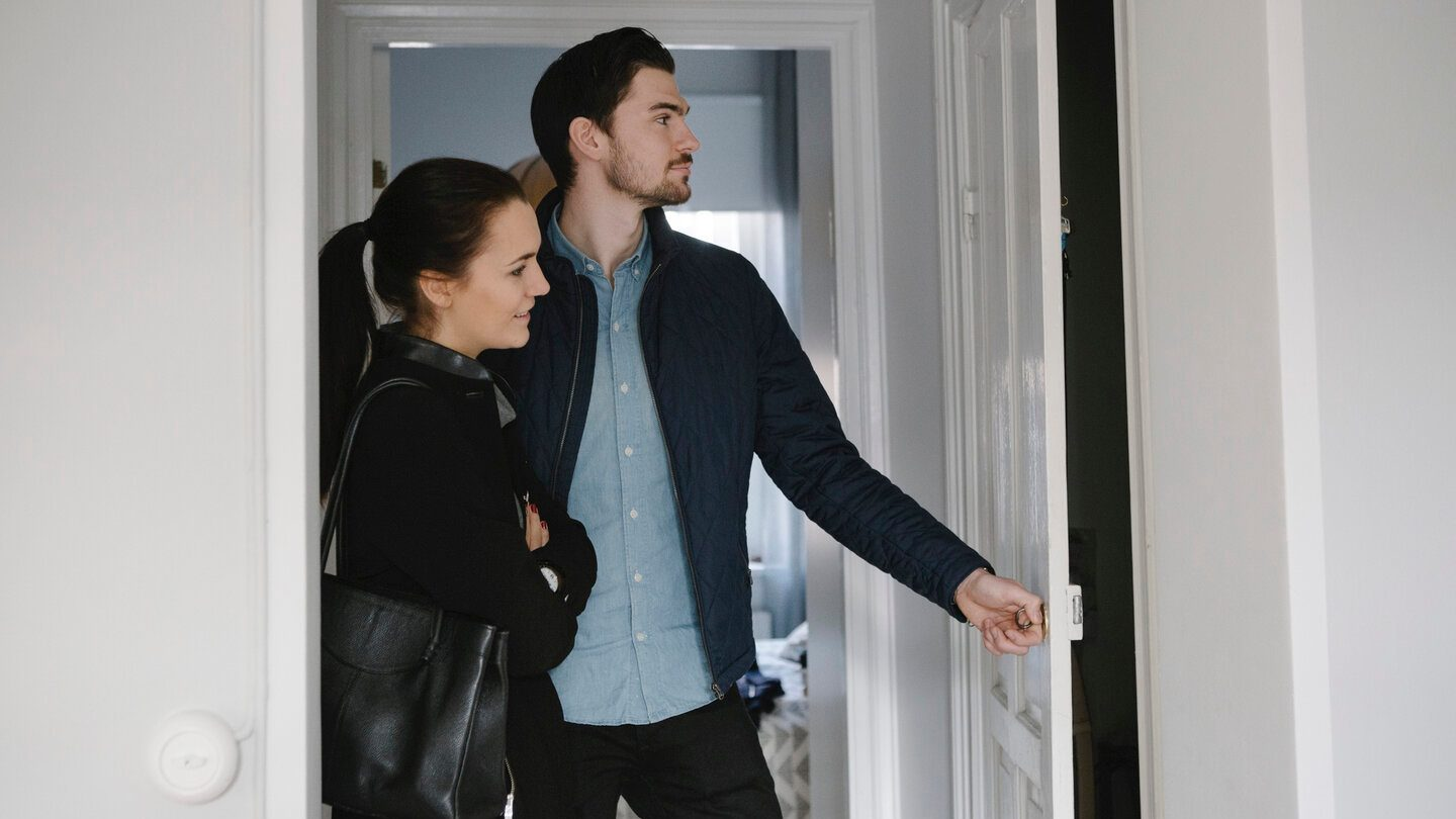 couples inspecting a home to not regret buying it later
