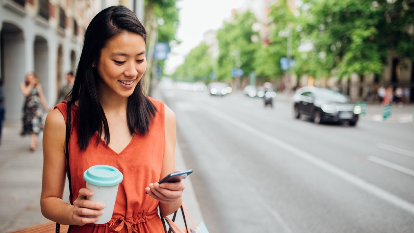 woman-looking-at-mortgage-rate-on-phone