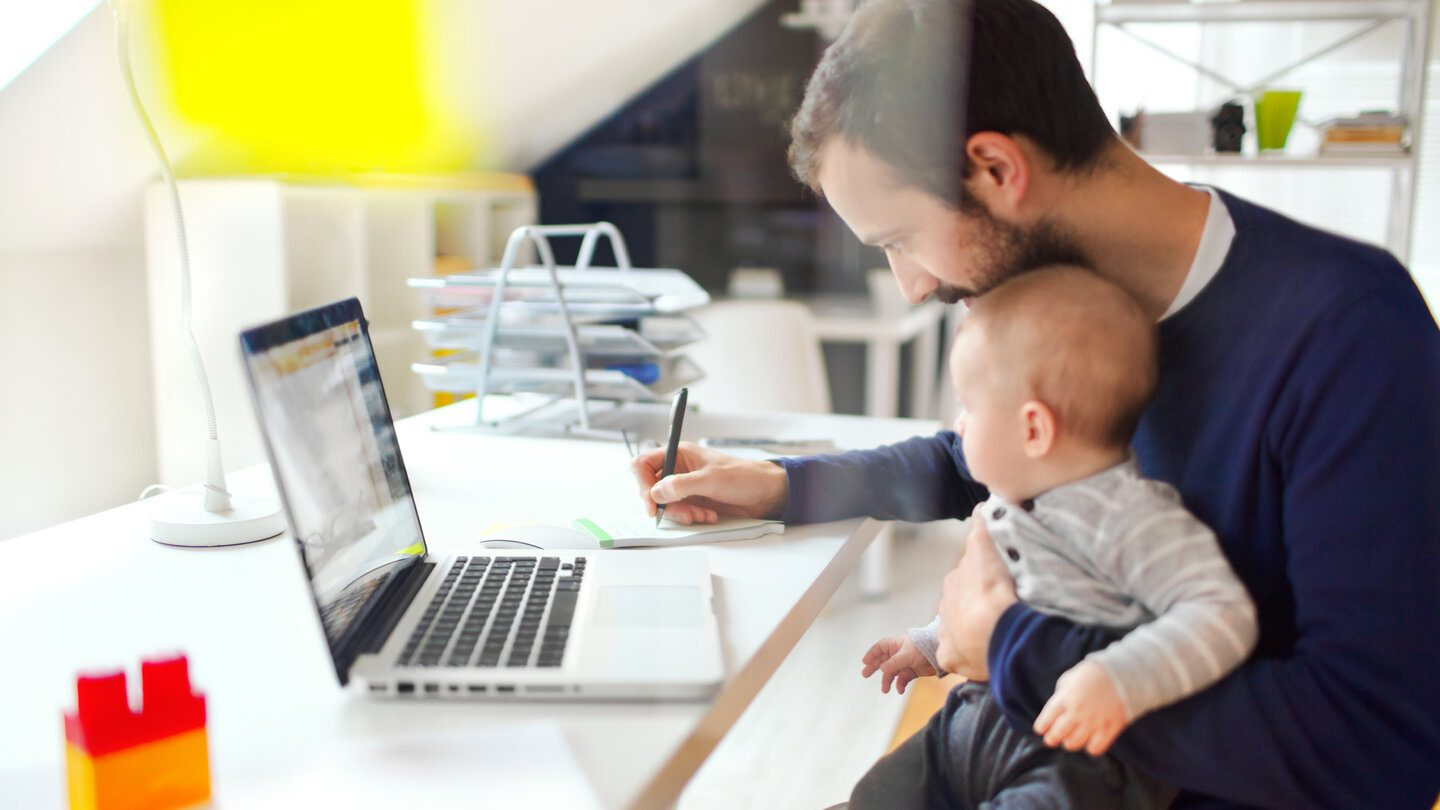 Father with child on his lack considering refinancing his home loan