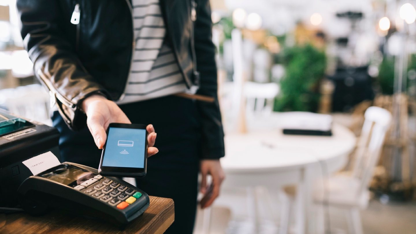 woman-paying-with-smartphone