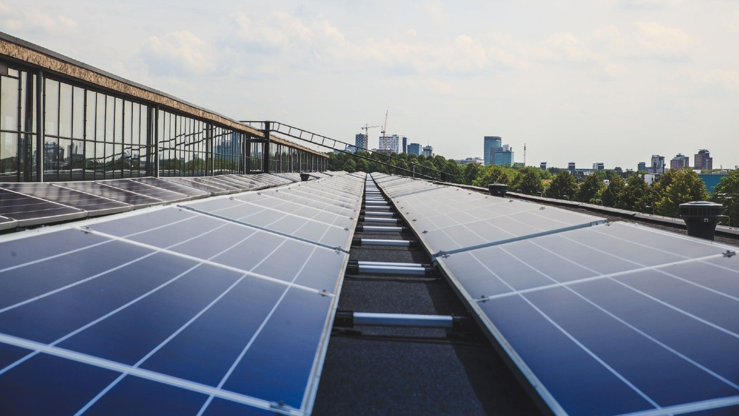 Rooftop solar with skyline in background