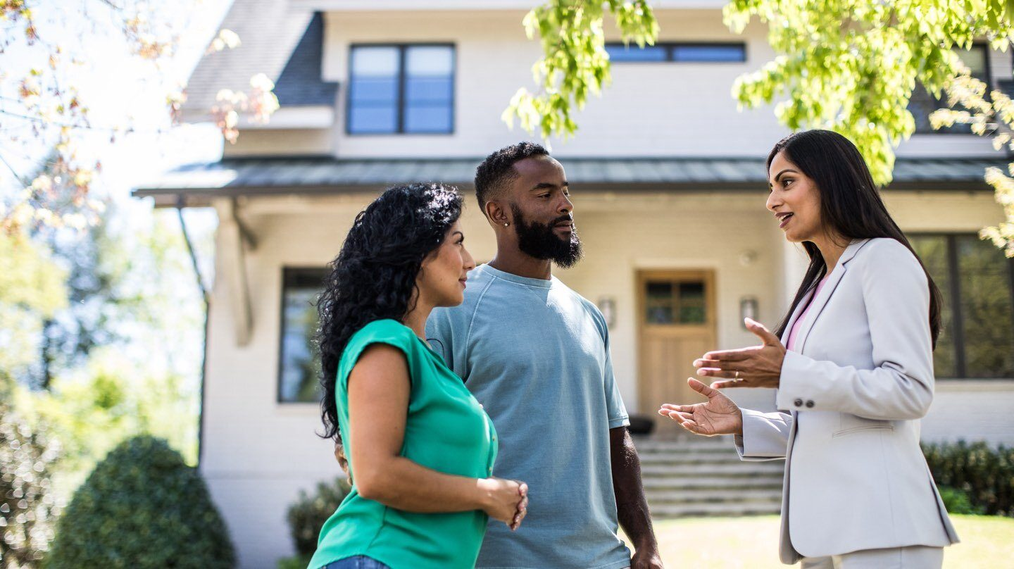Couple talking to a potential real estate agent