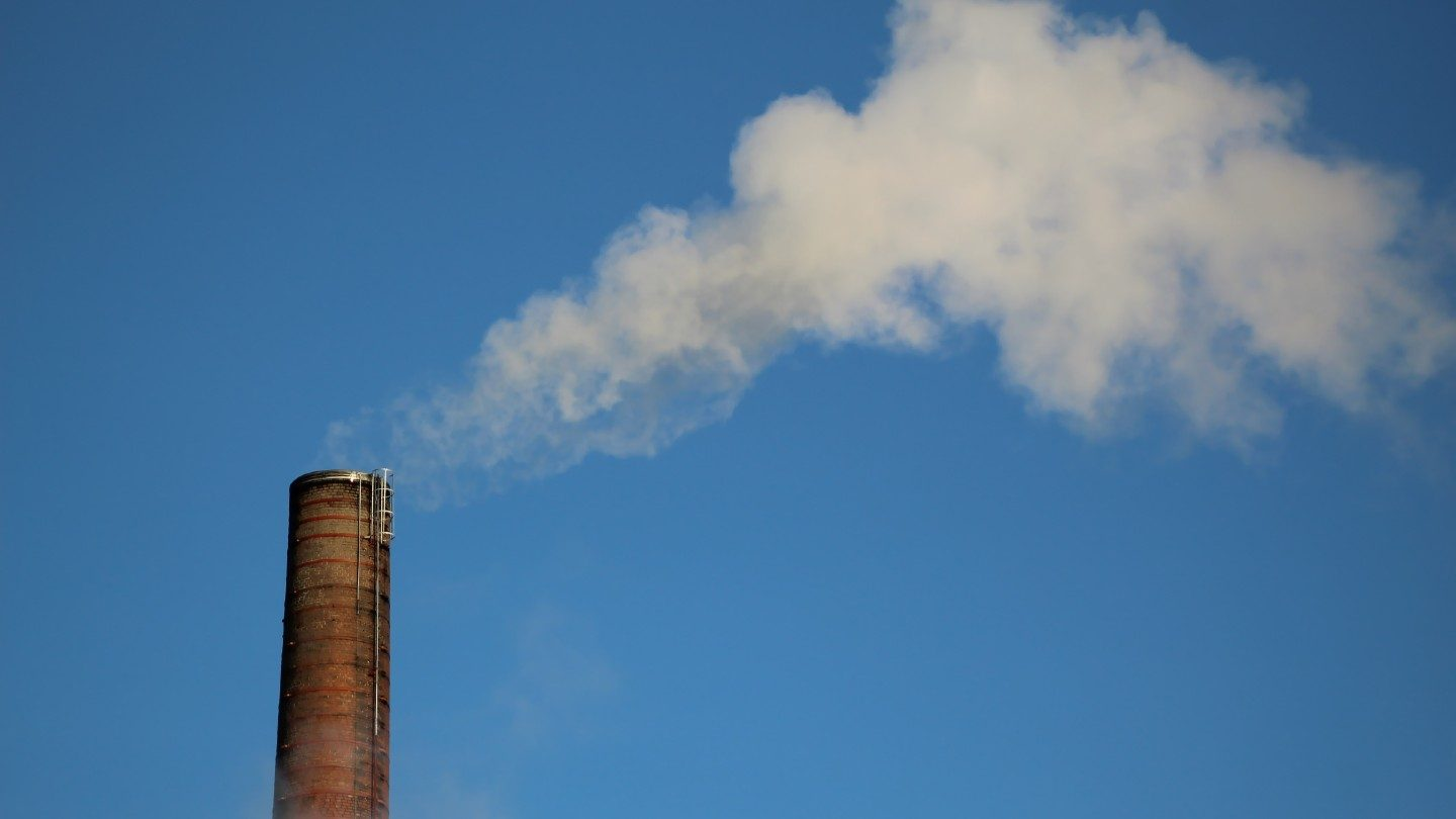 Smoke stack with blue sky background