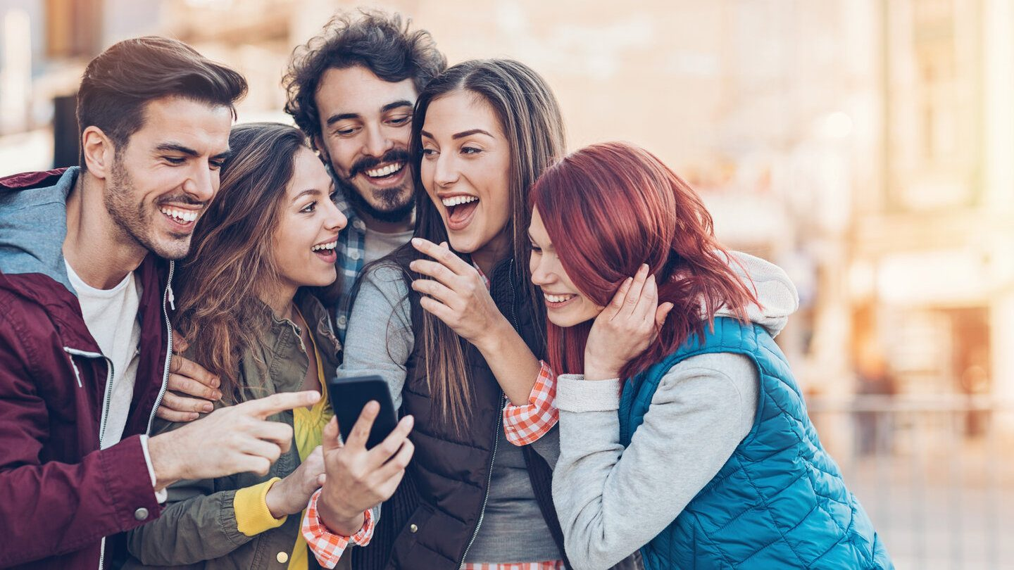 friends looking at home loans together