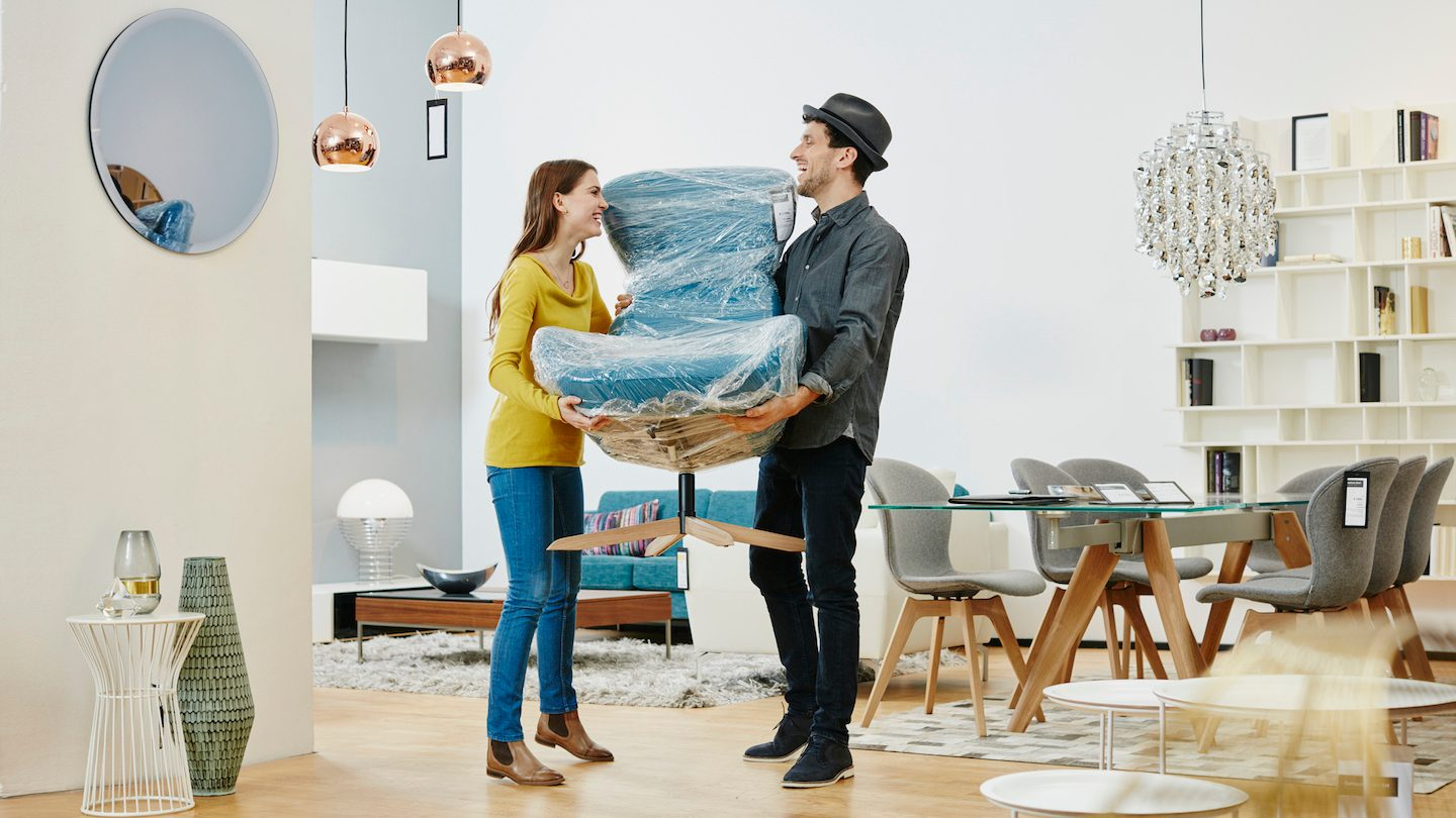 couple buying home chair using buy now pay later