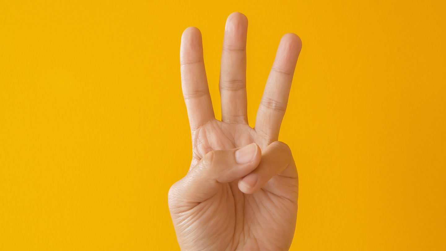 hand holding up three fingers to show three expert finance tips