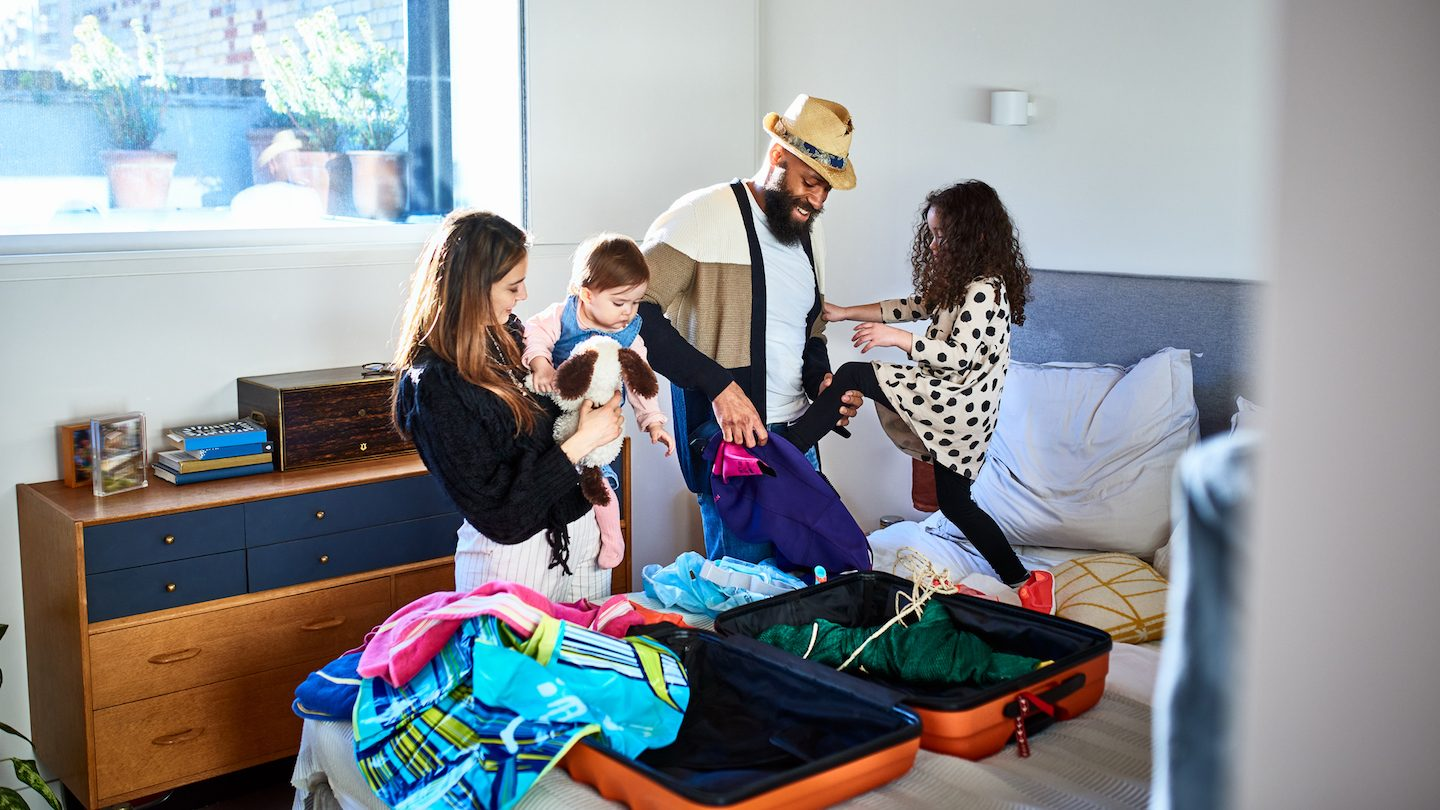 family packing suitcase for international travel 2022