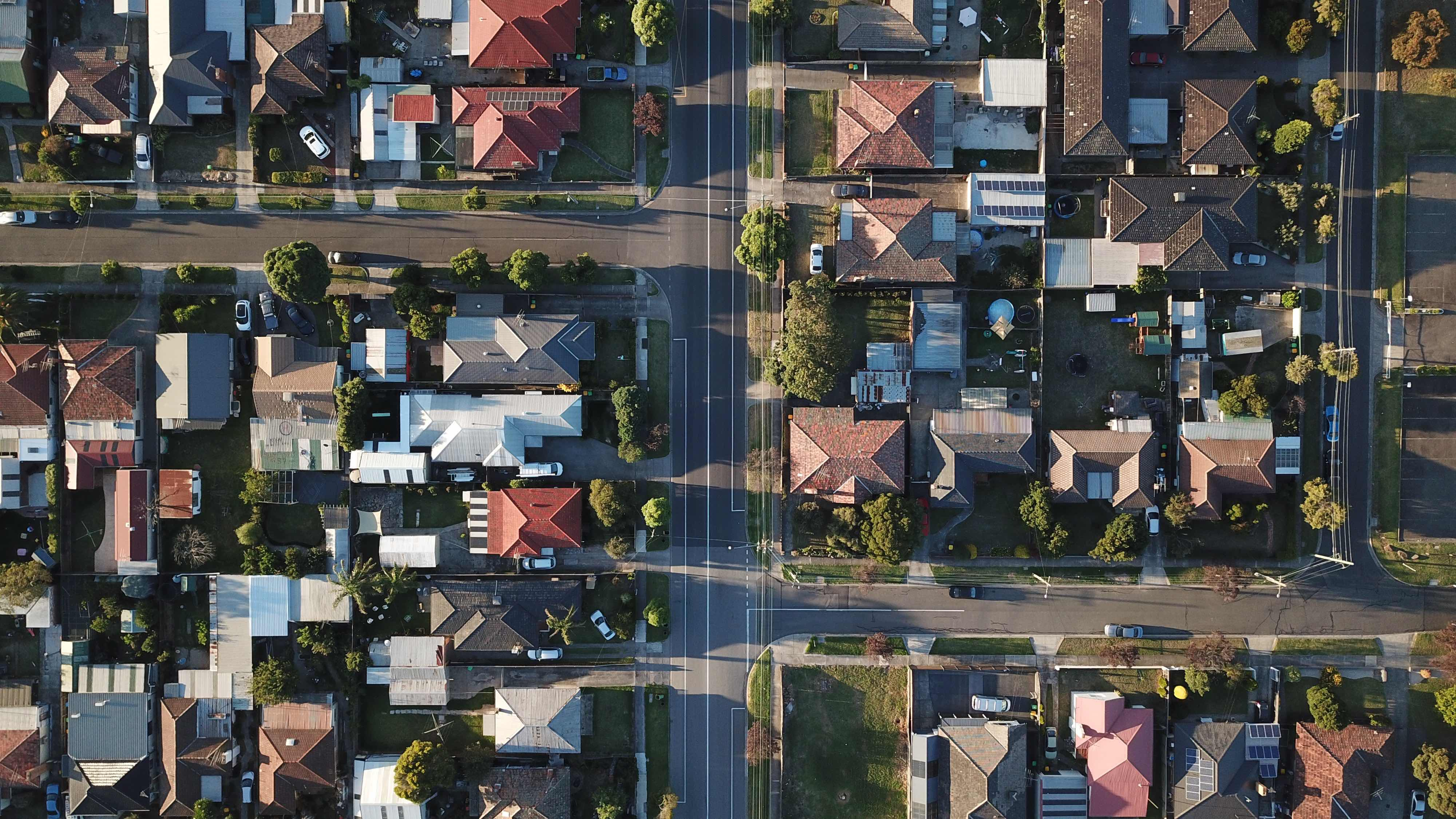 Aerial view of houses and streets, as property sales surge to a near 12-year high.