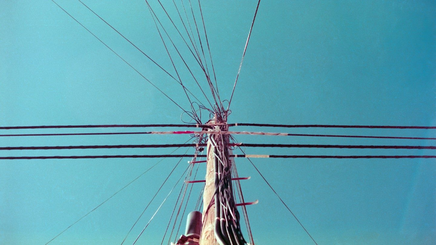 Utility pole with phone lines