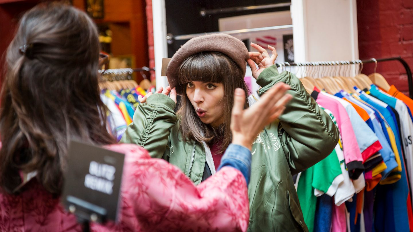 woman trying on new hat purchasing with buy now pay later
