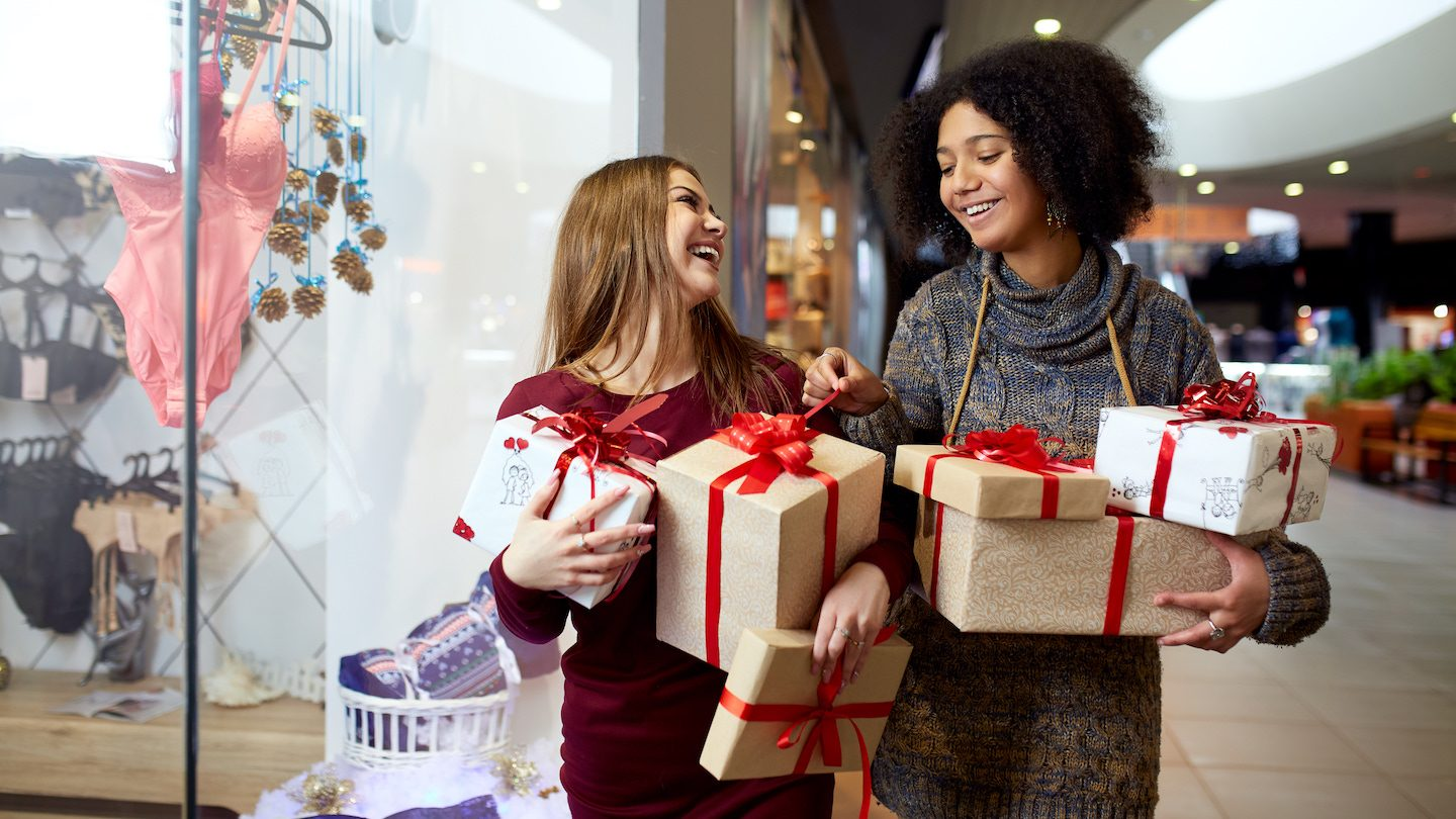 woman christmas shopping using buy now pay later