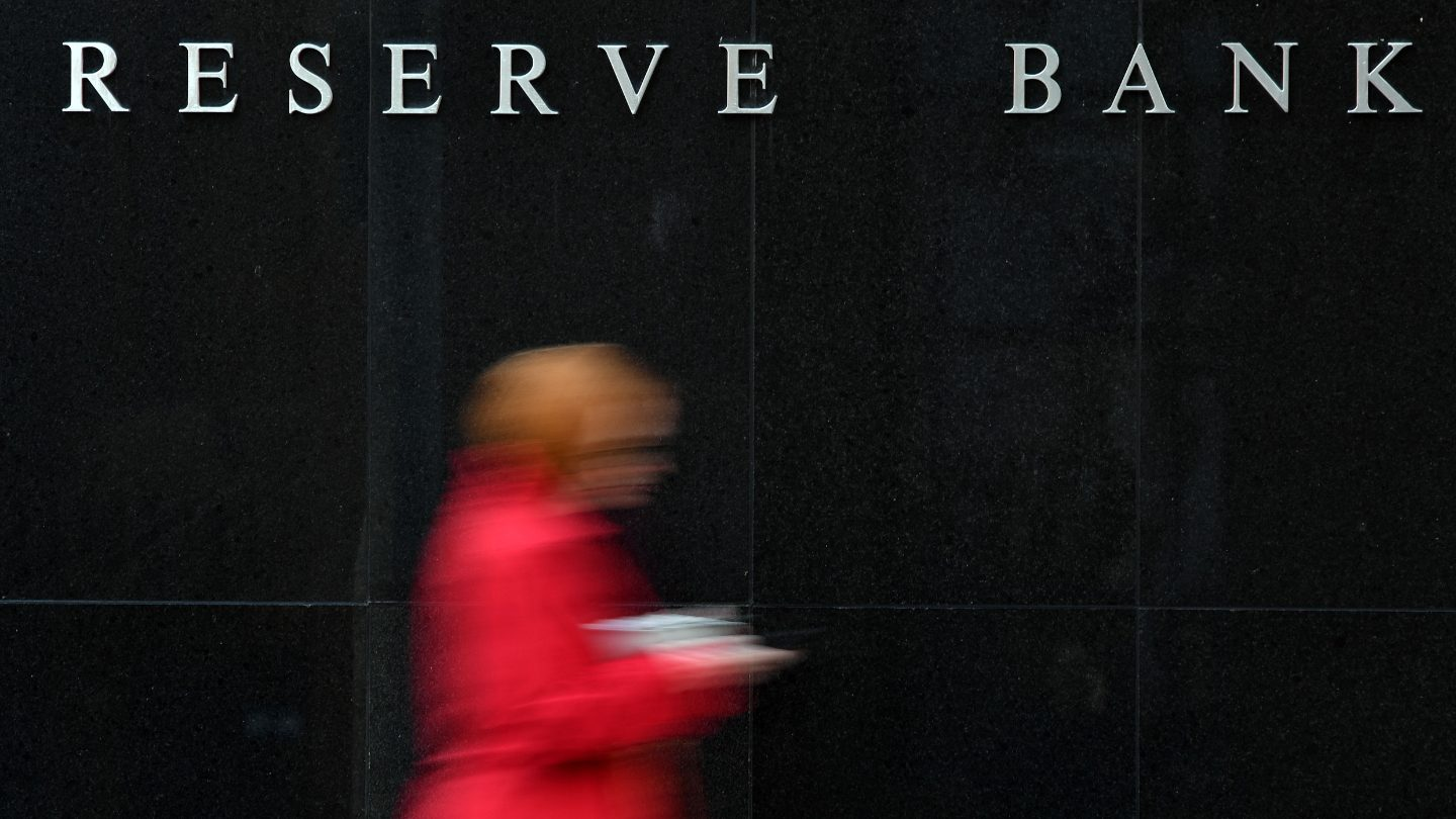 Person walks past the Reserve Bank of Australia.