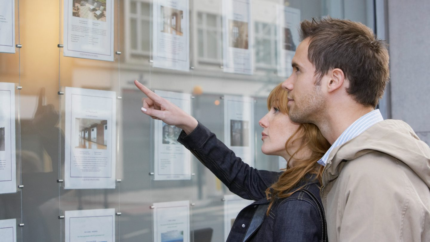Young couple looking at real estate.