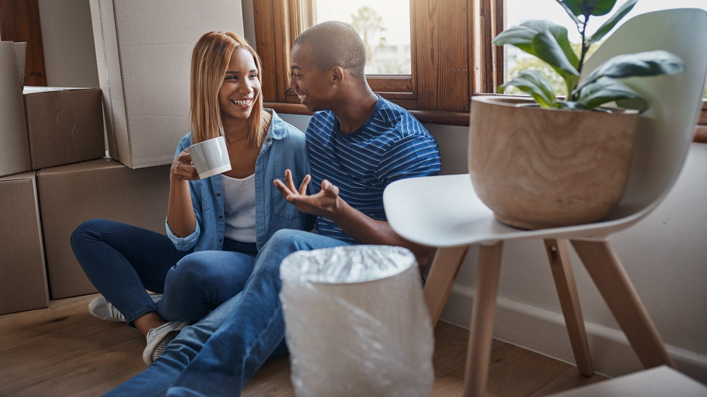 couple excited to be able to afford a new home with low rates