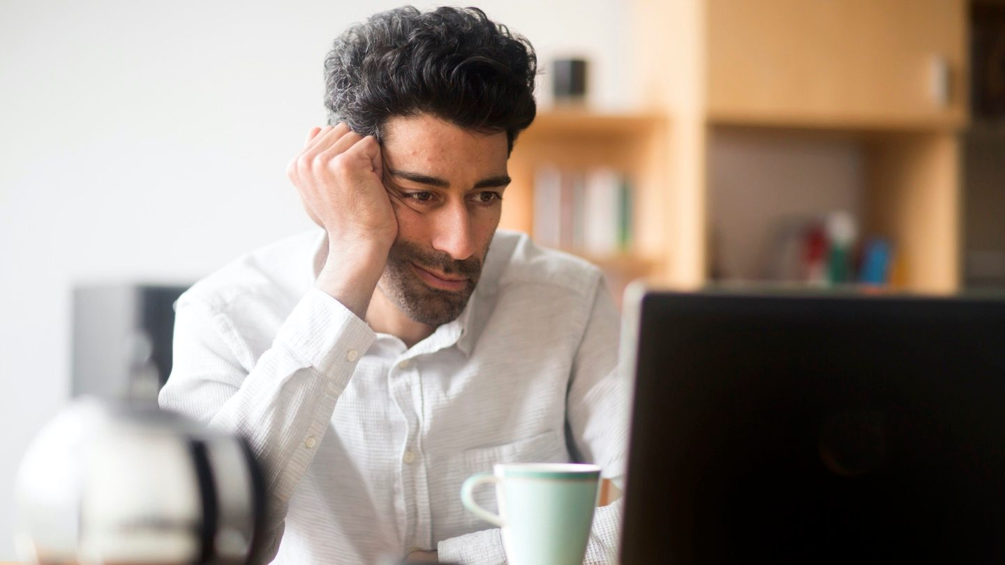 Man laptop frustrated content