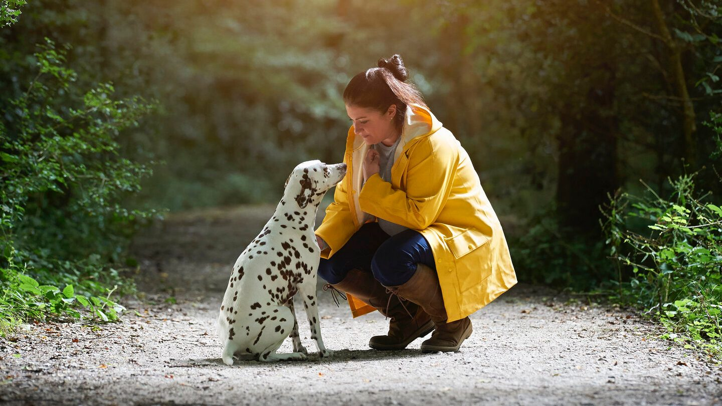 Woman and her dalmatian out on a hike