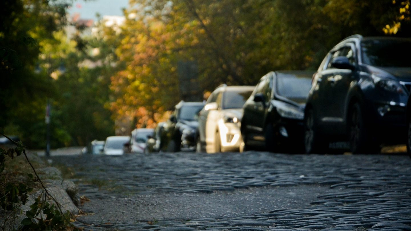 A flood street with parked cars.