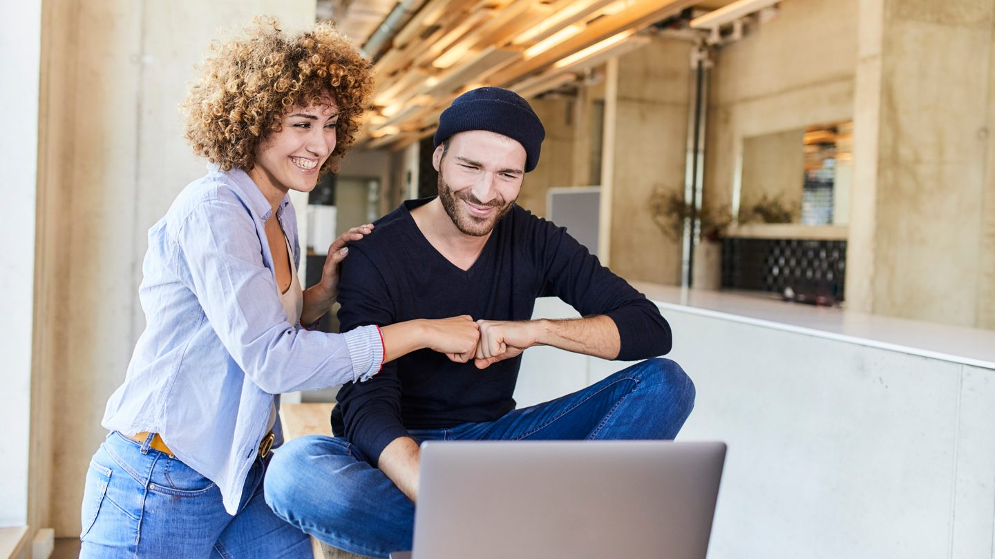 young couple on laptop exploring personal loan providers