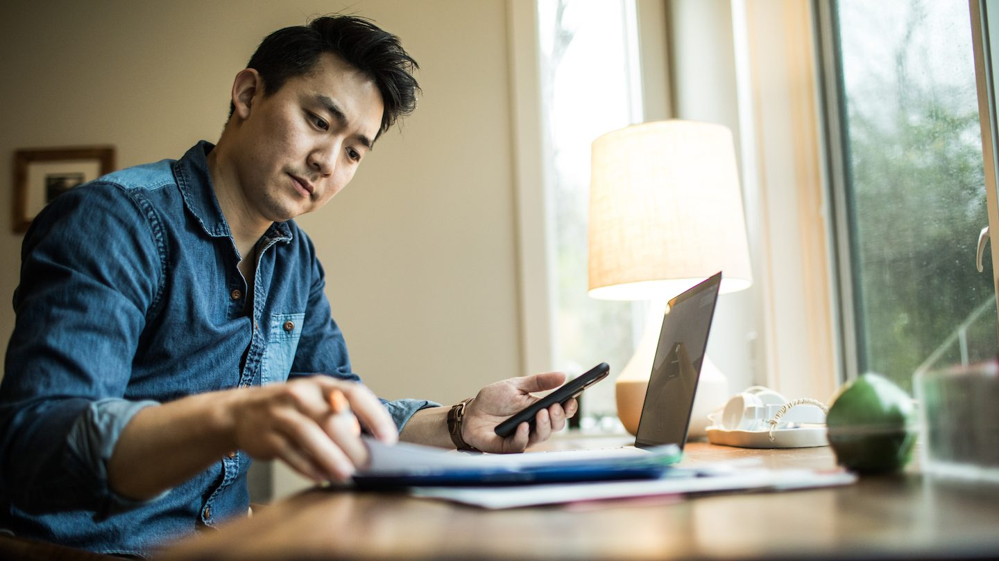 man weighing up personal loan or home loan redraw