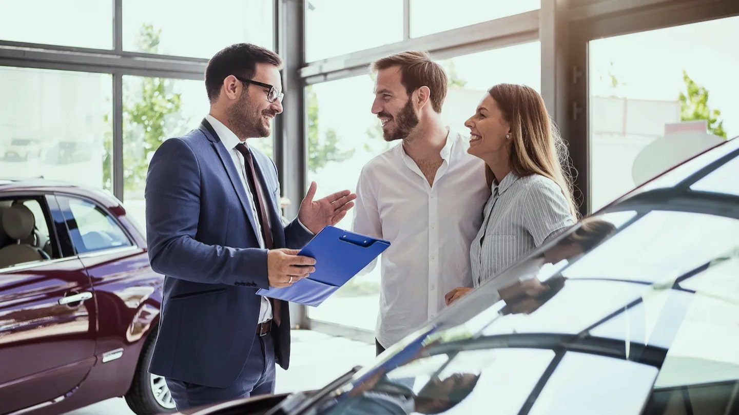 couple discussing cost of a car with vehicle finance
