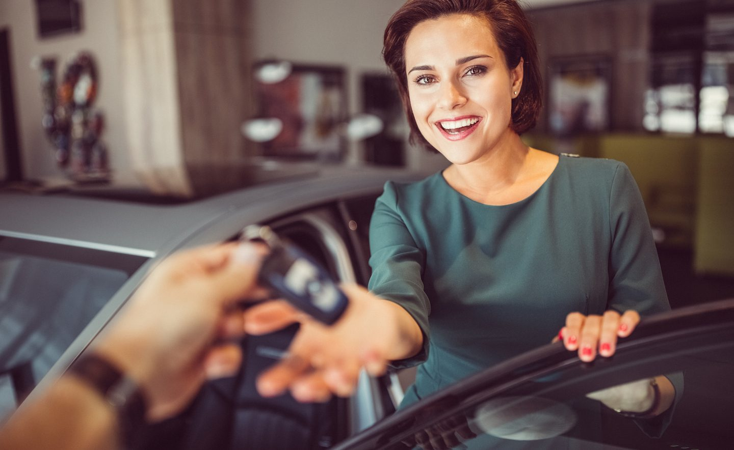 woman-being-handed-keys-to-used-car