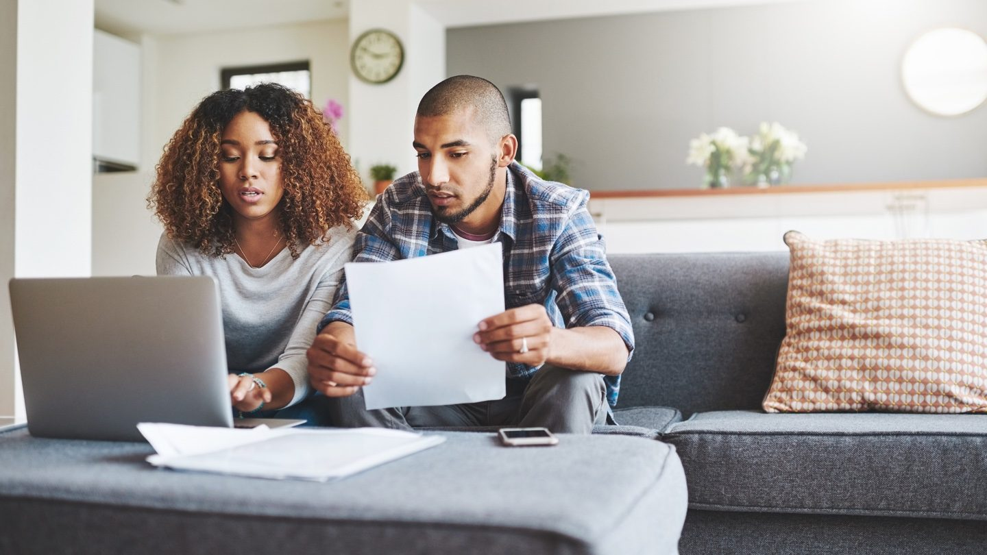 young-couple-consolidating-debt-with-loan