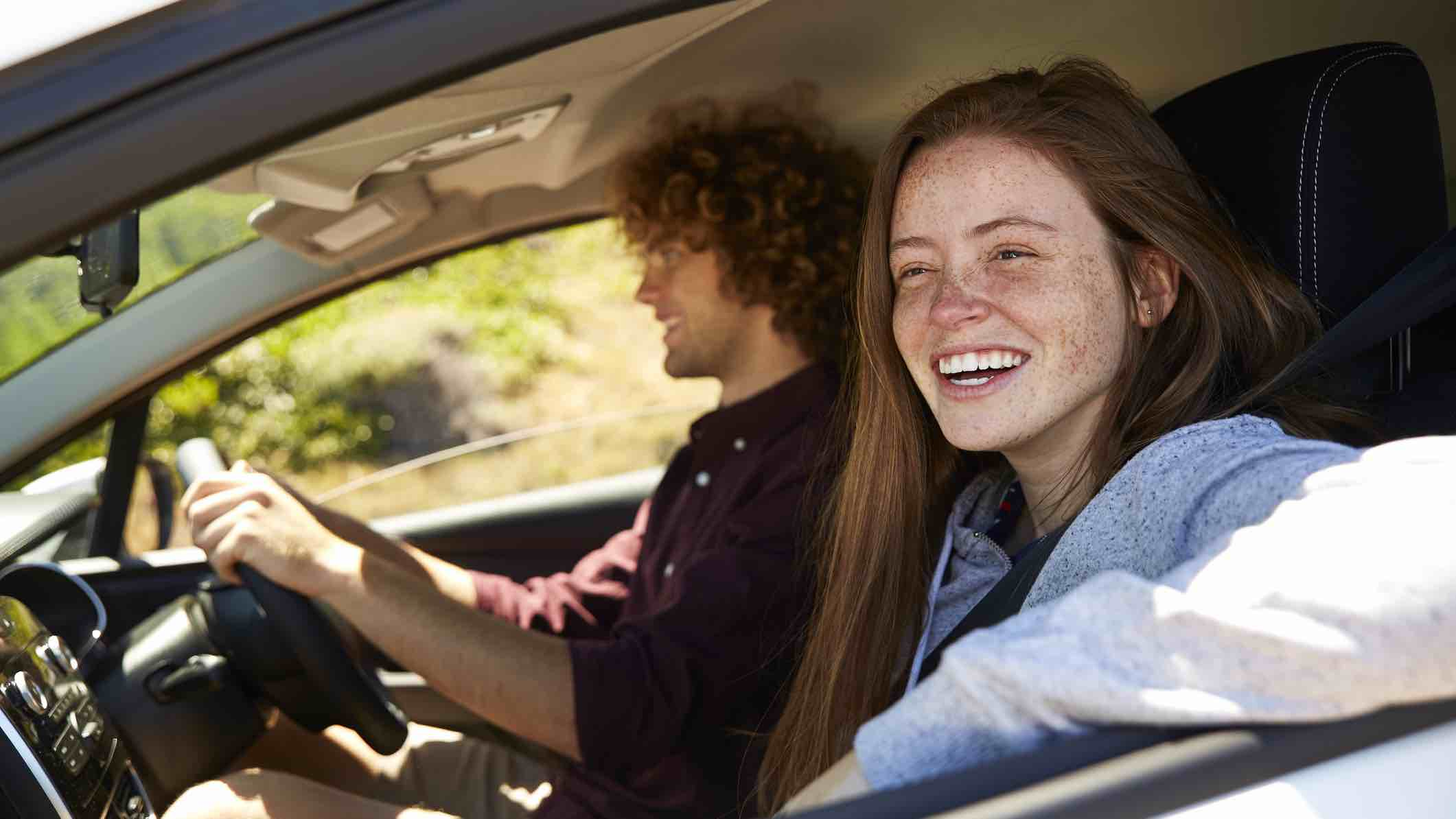 Young people driving with insurance