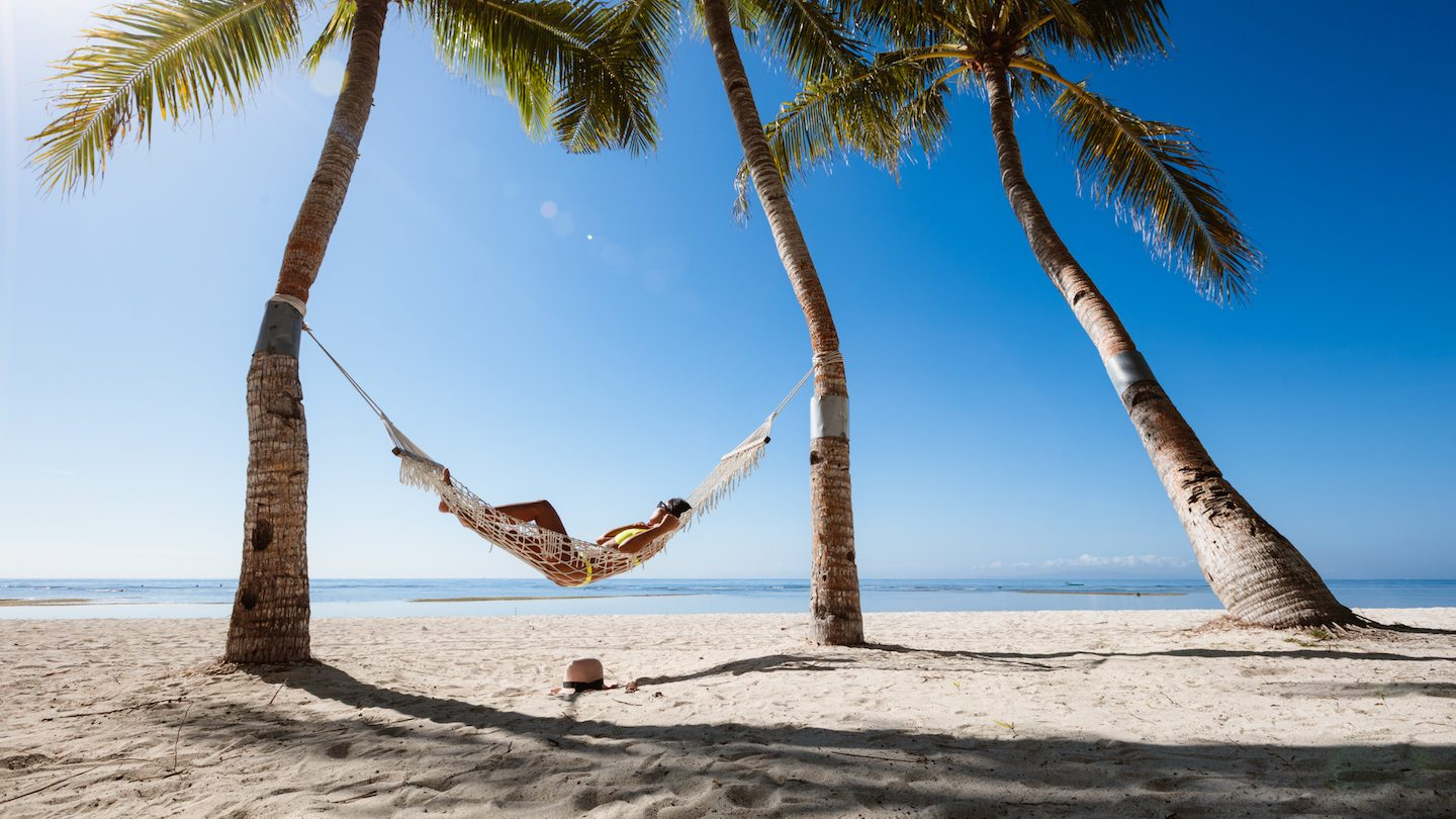 woman in a hammock paid for tropical holiday with loan