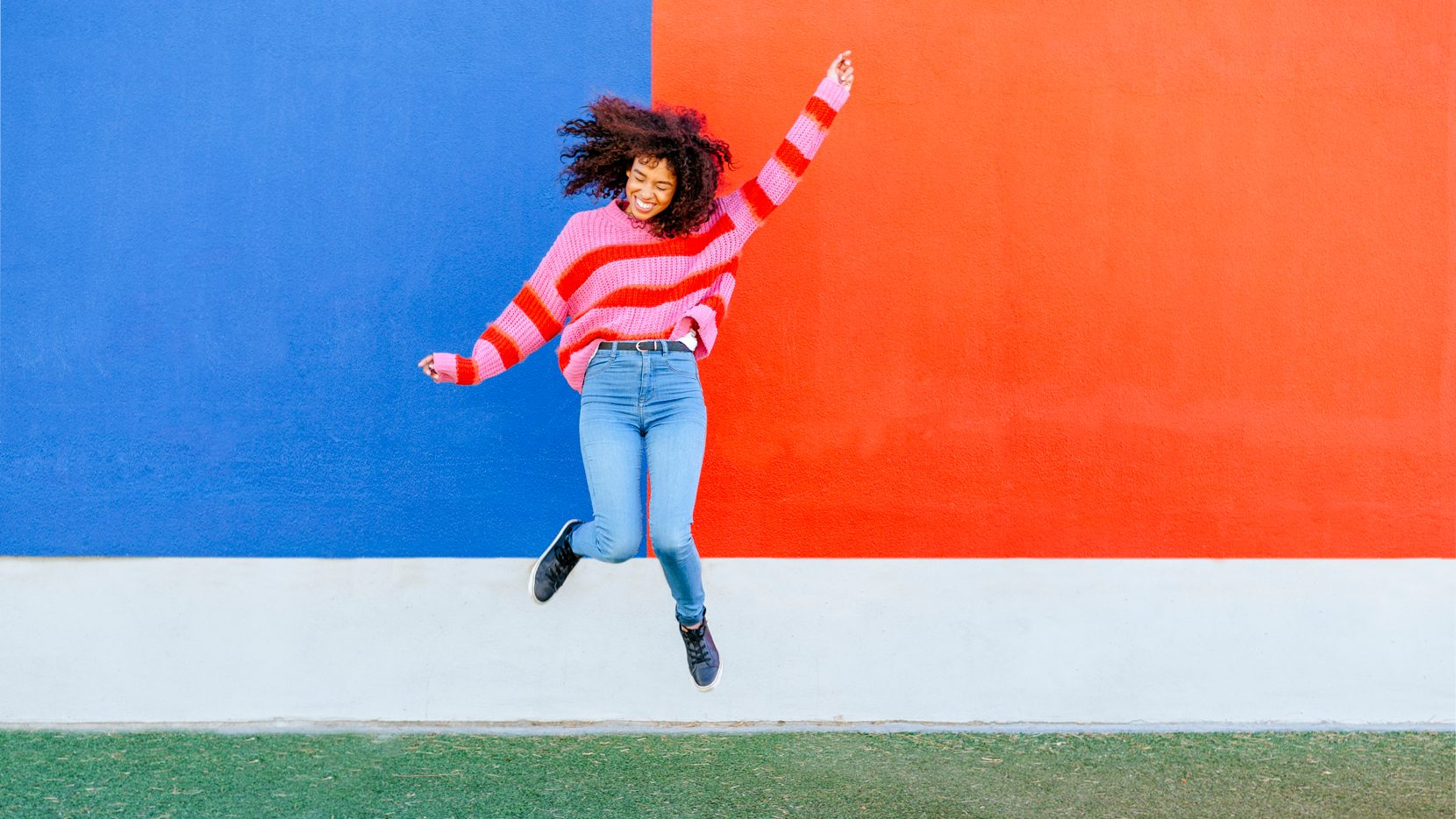 happy-woman-jumping-because-cleared-debt