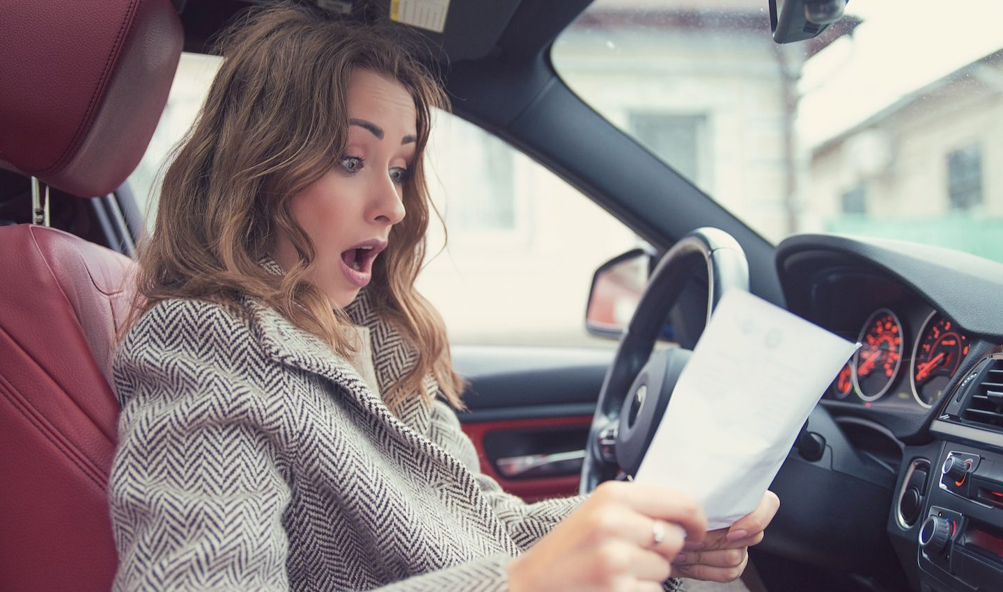 woman shocked because can't pay car loan