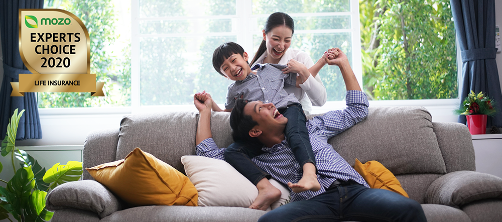 Mother, father and child playing on sofa, celebrating Insure Me Now's Mozo Experts Choice Life Insurance Award win.